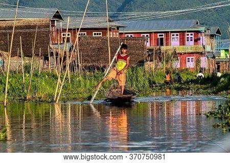 Inle Lake, Myanmar - Nov 08, 2019: Fisherman Rowing Boat By One Leg On Inle Lake, Myanmar. Inle Lake