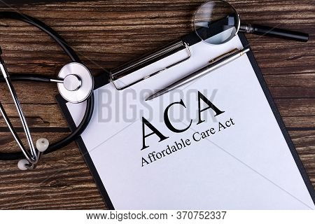 Page With Aca Affordable Care Act On The Table With Stethoscope, Medical Concept