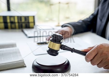 Judge Gavel With Justice Lawyers, Counselor In Suit Or Lawyer Working On A Documents In Courtroom, L