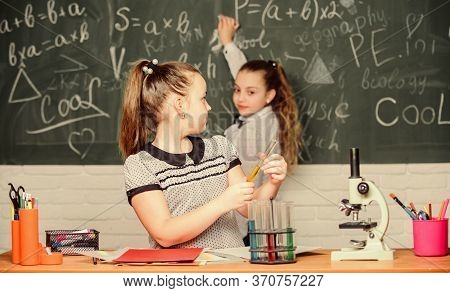 Back To School. School Classes. Girls Study Chemistry In School. Microscope Test Tubes Chemical Reac