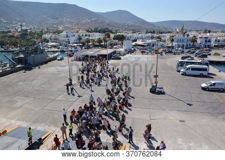 Paros, Greece - September 17, 2016: Passengers And Cars Embark On A Ship At The Port Of Paros In Gre