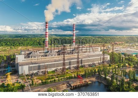 Aerial View Of Thermal Power Station. Industrial Landscape With Thermal Power Plant, Pipes With Smok