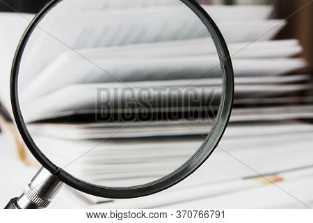 Open Book With A Magnifying Glass. Focusing On The Magnifying Glass. Closeup, Selective Focus