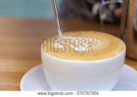 Latte Art. Art Of Drawing On Coffee. A Drawing Of A Swan On A Foam Latte. Barista Doing Latte Art.