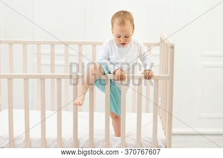 Baby Climbs Out Of The Crib, Baby Boy 2 Years Old In The Crib