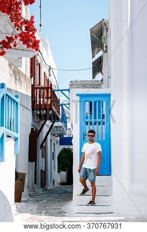 Young Guy On Vacation At The Greek Island Of Mykonos, Men Relaxing At The Little Venice Village Of M