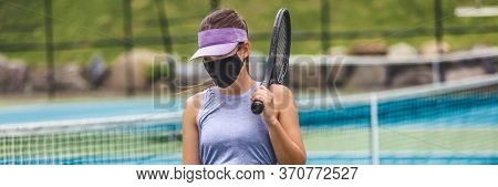 Tennis court reopen after covid-19 confinement. Woman athlete player wearing face mask during game playing oustide on outdoor courts banner panoramic.