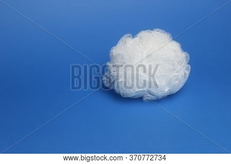 White Washcloth On Blue Background For The Body