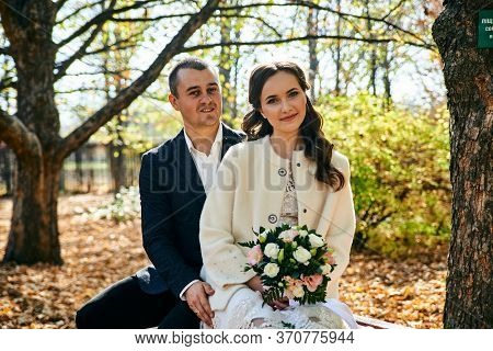Young Male And Woman Just Married. Concept Of Happy Family. Modern Family Outdoor.