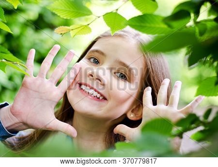 Portrait Of Adorable Smiling Little Girl Child Preteen In The Park Outdoors Closeup