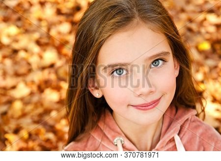 Autumn Portrait Of Adorable Smiling Little Girl Child Preteen In The Park Outdoors Closeup