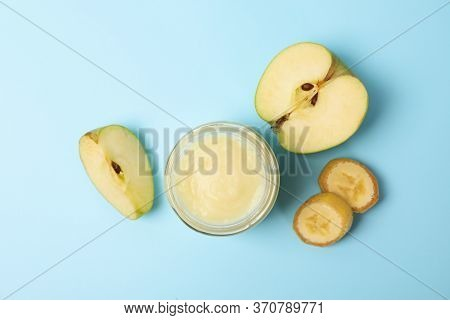 Glass Jar With Apple Puree On Blue Background, Top View