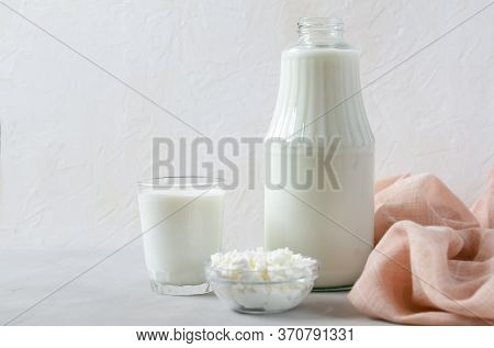 Homemade Fermented Beverage In A Glass - Kefir, Cottage Cheese, On A White Background. Sour Milk Dri