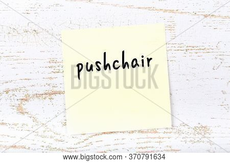 Yellow Sticky Note On Wooden Wall With Handwritten Inscription Pushchair