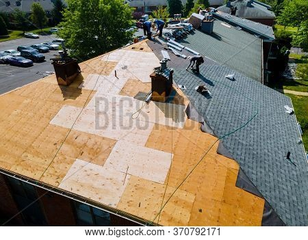 Roof Repairs Old Roof Replacement With New Shingles Of An Apartment Building