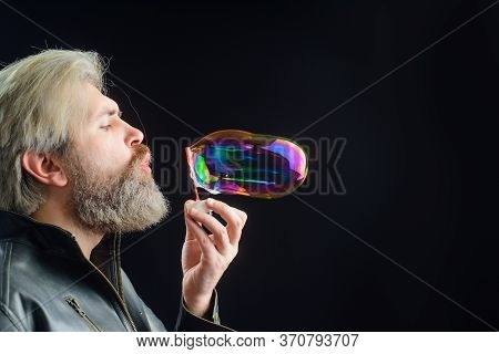 Bearded Man Blowing Bubbles. Soap Bubbles. Play With Bubbles. Bearded Man Blowing Soap Bubbles. Happ