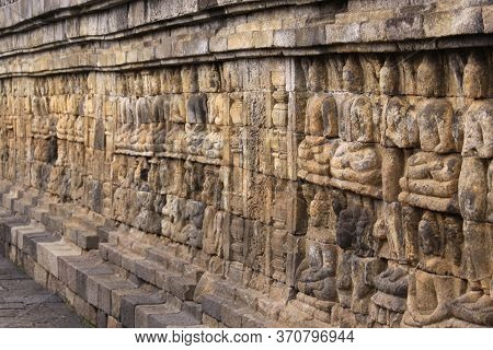 Borobudur Temple Base Sculpted Detail, In Java, Indonesia. Candi Borobudur Is The Largest Buddhist T