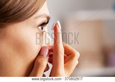 Contact Lens For Vision. Young Woman Puts On Optical Lenses At Home In The Room