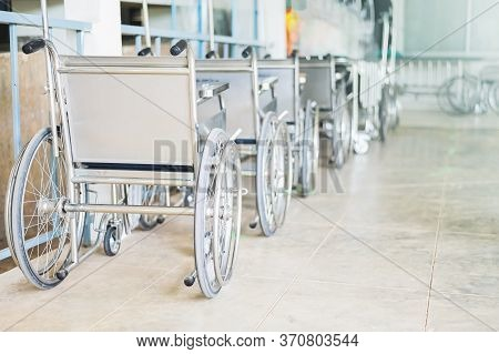 Wheelchairs In The Hospital , Wheelchairs Waiting For Patient Services. With Light Copy Space On Lef