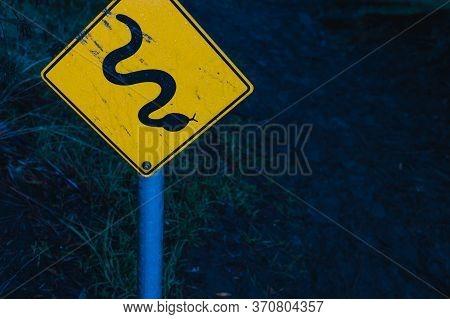 Snake Danger Road Sign At The Entrande To A Bush Track In Tasmania, Australia