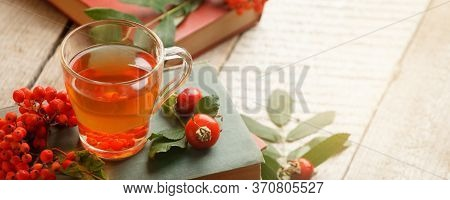 Reading In The Autumn Day. Retro Autumn Books And Tea,rowan, Berry, Rosehip On A Wooden Table. Cozy
