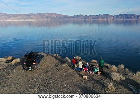 Pyramid Lake, Reno, Nevada - January 18, 2020 - Family Enjoys Tranquil Winter Afternoon On Lake.