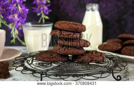 Stack Of Double Chocolate Chip Homemade Cookies In Creative Vintage Setting.
