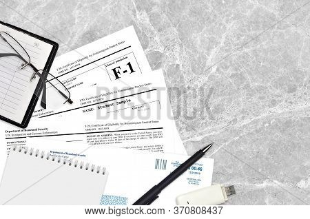 Uscis Form I-20 Certificate Of Eligibility For Nonimmigrant Student Status Lies On Flat Lay Office T