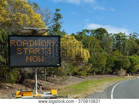 Roadworks Start Now Portable Led Sign On A Suburban Road