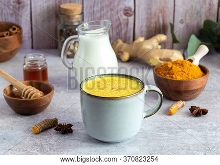 Mug With Golden Turmeric Milk And Cinnamon, Honey, Ginger. Ayurveda Treatment. Alternative Medicine