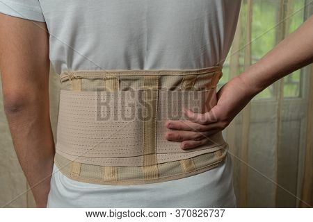 Lumbar Brace On The Human Body. Trauma Of Back. Back Brace, Orthopedic Lumbar, Support Belt For Back