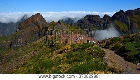 Pico Do Arieiro, Maderia, Portugal - June 25, 2019  : Tourists At The Top Of Pico Do Arieiro One Of