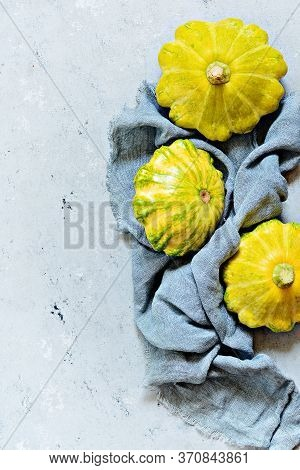 Squash Vegetable. Group Of Green And Yellow Pattypan Squashes. Ripe Squash On A Gray Background.