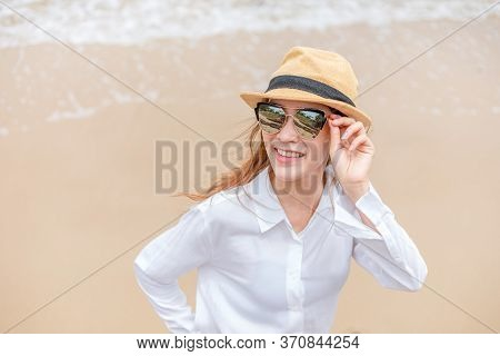 Smiling Young Woman In Sun Hat And Waring Sun Glasses On The  Beach. Summer, Holidays, Vacation, Tra