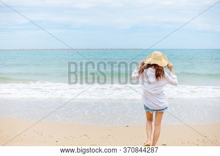 Happy Young Girl Walking On The Beach. Summer Travel, Vocation, Holiday Concept.