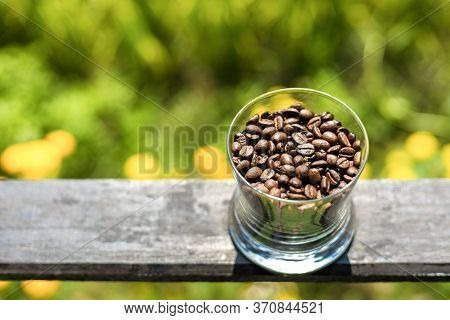 Coffee Seed In Glass On The Table.