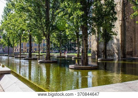 Parma, Italy - July 8, 2017: View Of A Fountain With Trees In Piazzale Della Pace On A Sunny Day