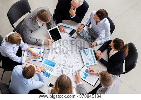 planning, strategy and corporate concept - business team with scheme meeting and discussing problem at office