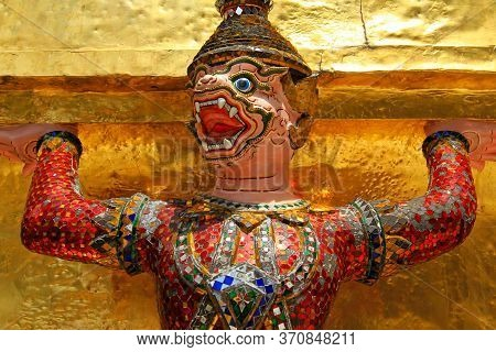 Statue Of A Monkey Or Giant In The Ramayana Story With Golden Background At Wat Phra Kaew Or Other N