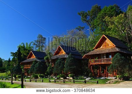 Thee Wooden House With Tree And Clear Blue Sky At North Of Thailand. Exterior Design And Beautiful I
