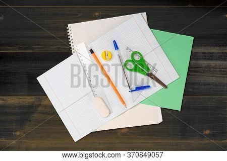 School Stationery As Checkered Notebook, Scissor, Pencil With Eraser, Pen With Cap, Ruler, Eraser An