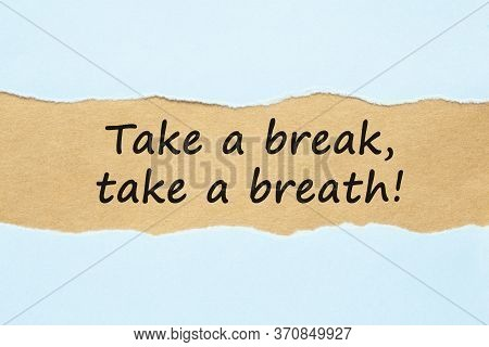 Text Massage Take A Break, Take A Breath Appearing Behind Ripped Blue Paper. Stress And Burnout Conc