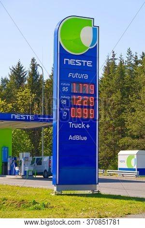 Tallinn, Estonia. 11.06.2020 Neste Oi, Logotype On A Neste Fuel Station With Fuel Price. Diesel 0, 9