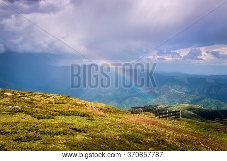Green Valley Nature Landscape With Rainbow. Mountain Layers Landscape. Rainbow In Mountain Meadow La