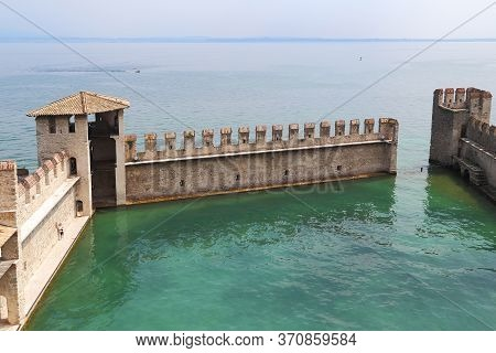 Sirmione, Italy - May 13, 2018: This Is An Unusual Fortified Harbor Of The Scaliger Castle.