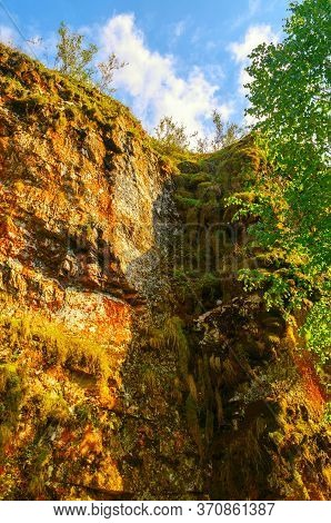 Summer mountain landscape, mountain wall of Ustinovskii Canyon in Southern Urals, Russia, summer mountain sunny view, stone mountain wall in the summer mountain forest