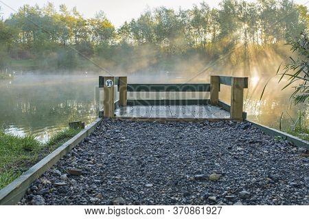 Fishing Peg Looking Out Over A Lake In The Early Morning