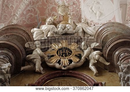 ZAGREB, CROATIA - MAY 16, 2013: Holy Trinity and Angels, statue on the altar in the Church of Saint Catherine of Alexandria in Zagreb, Croatia