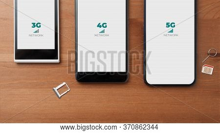 Mobile Network Evolution Concept: Comparison Between 3g 4g And 5g Smartphones On A Wooden Table