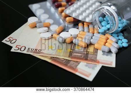 Pills And Capsules On Euro Bills. Concept Of Health Care, Pharmaceutical Business, Drug Prices In Eu